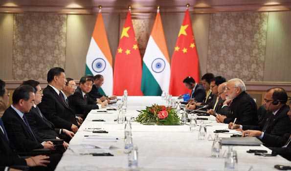 At bilateral meet PM Modi and Prez Xi Jinping agree to boost closer partnership