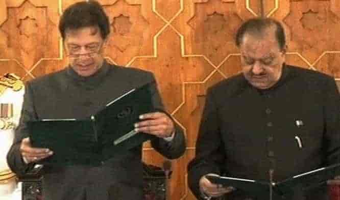 Prime Minister Islamic Republic of Pakistan Imran Khan taking oath at Aiwan-e-Sadar Islamabad. Photograph PTI Official