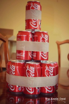 """How to make a Soda Can Cake with a 12-pack of soda. I love how fast and easy it was to make this soda cake - it ended up being the perfect size. The beauty of this """"Soda"""" cake is that you can use any canned drink it doesn't have to be soda. It's a great gift idea when you don't know what to get."""