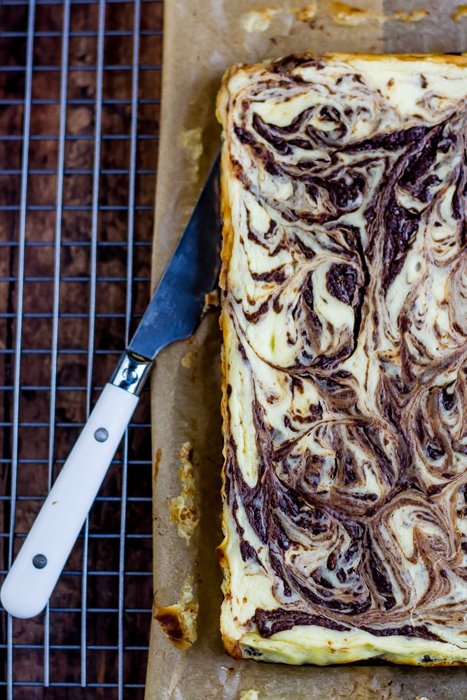 Fancy Chocolate Cheesecake Bars swirled and pretty.