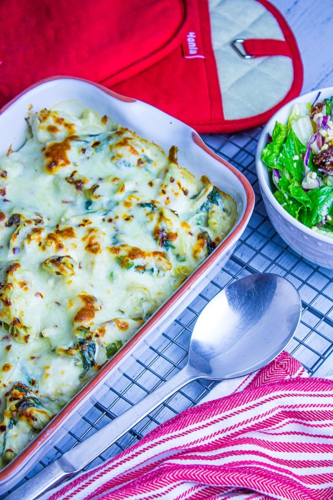 Keto Chicken Artichoke Casserole.  Creamy and filled with spinach, artichokes and chicken.  Kids love it and great as leftovers.