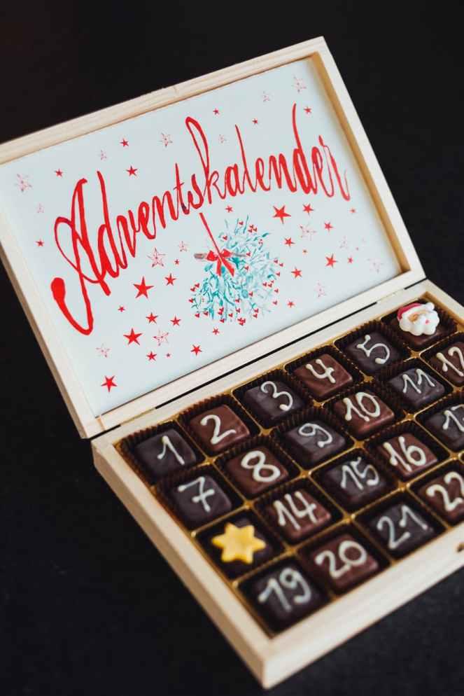 chocolates on white wooden box
