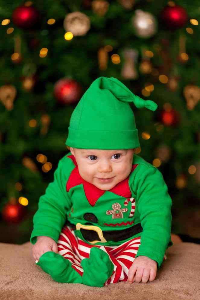 Baby sat dressed as an elf