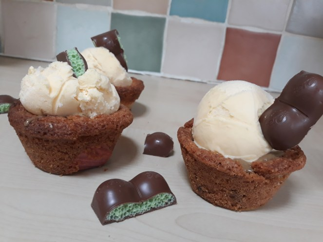 Mint aero cookie cups with mint aero chunks next to it on kitchen side