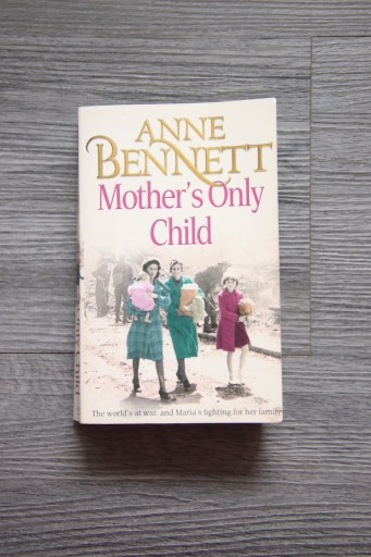 Mother's Only Child front cover showing two women and two children in a bombed out street.