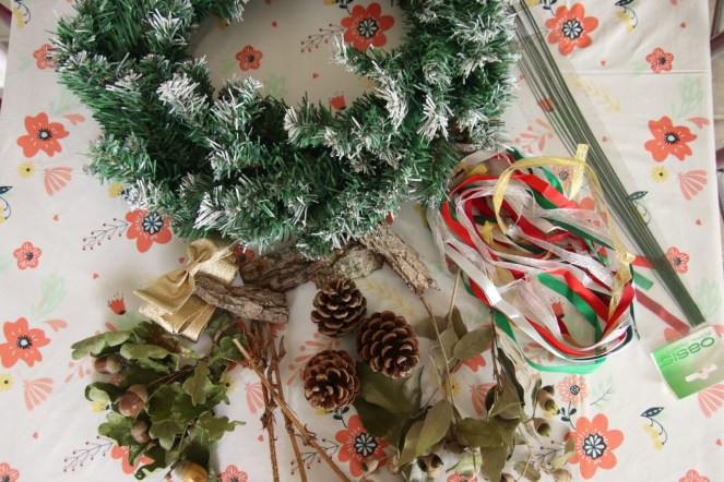 Items you will need to make a wreath including base, wire, coloured ribbons and natural bits.
