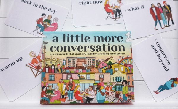 A Little More Conversation game box with category cards.