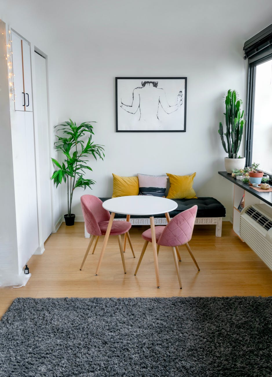 contemporary room interior with furniture and carpet on floor