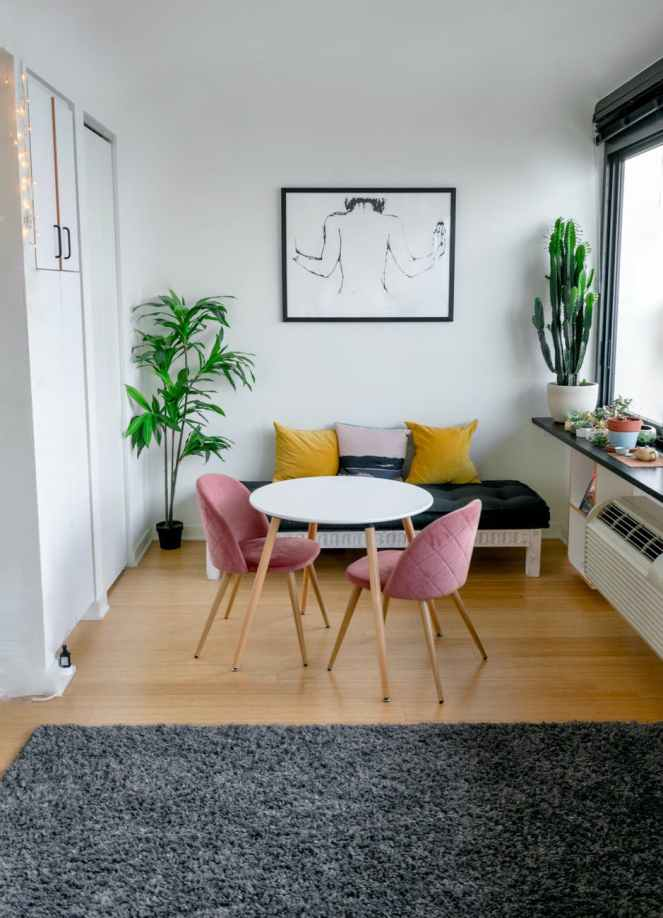 contemporary room interior with furniture and carpet on floor for how to add art to your rented home post.