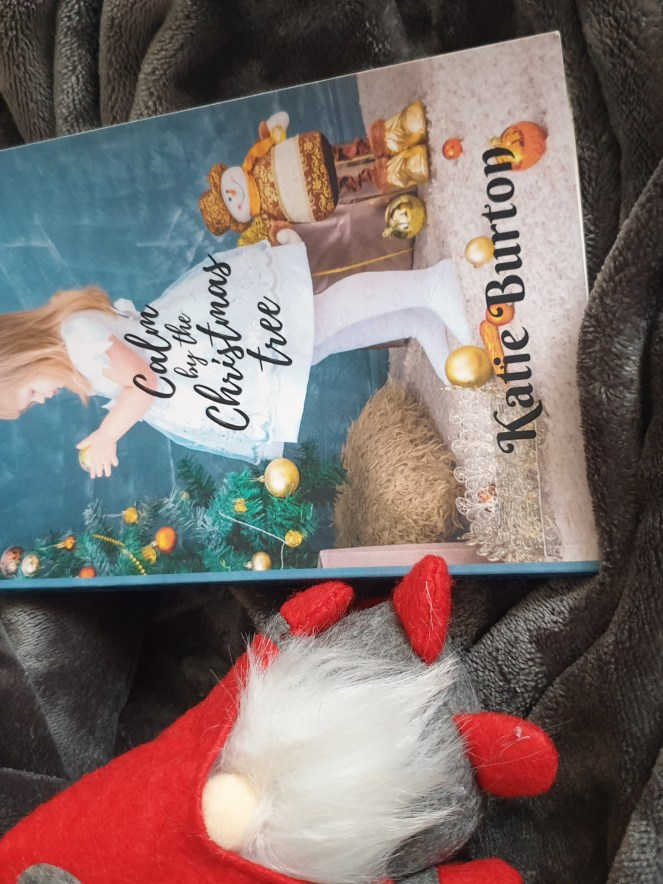 Calm By The Christmas Tree By Katie Burton front cover