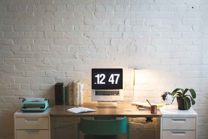 silver and black digital alarm clock on table for meet my October advertisers post.