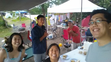 The Hawaii YMF officers bonding while camping on a beach