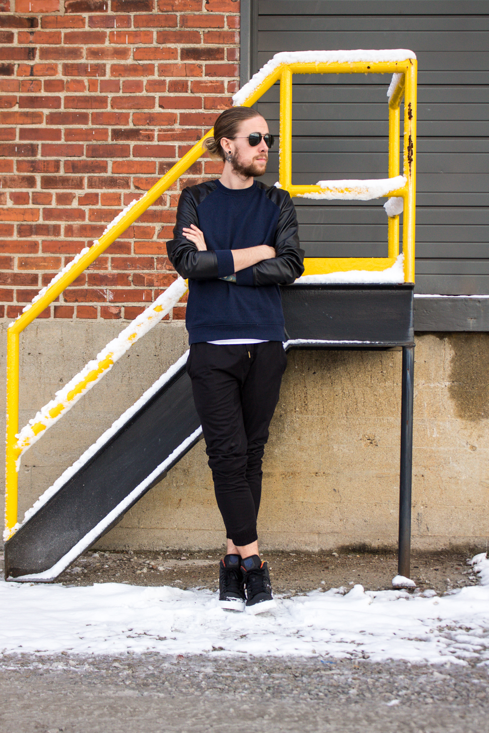 The Kentucky Gent, a Louisville, Kentucky life and style blogger, in Narrows Sweatshirt, Zanerobe Das Boro Mesh Joggers, Supra District 13 Vaider Sneakers, and Ray-Ban Aviator Sunglasses.