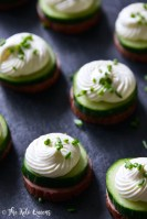 Summer Sausage Cucumber Bites with Cream Cheese Mousse and Fresh Chives on Slate Board