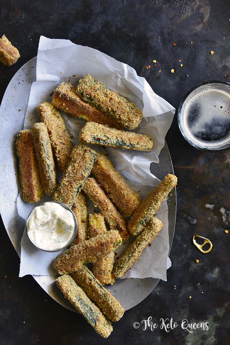 Low-Carb Keto Crispy Baked Zucchini Fries are sure to become your new favorite appetizer! They're crispy and loaded with flavor, not carbs. #ketoappetizeer