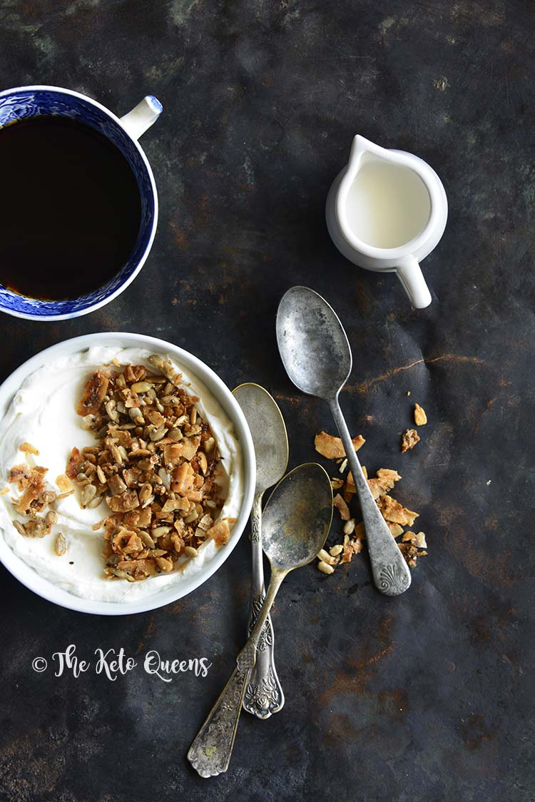This #LowCarb Homemade Granola Recipe is crunchy and sweetly satisfying, and reminds us of the sugar-heavy cereal bowls of our youth (hello, healthy Cinnamon Toast Crunch)…without the sugar!