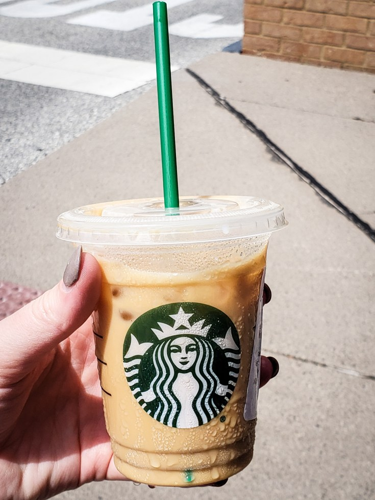 picture of a person holding a Iced Coffee with Heavy Whipping Cream