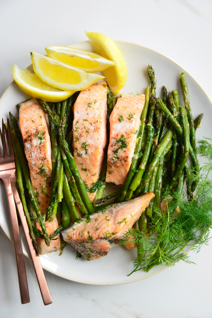 Our Butter Dill Baked Salmon with Roasted Asparagus is the perfect weeknight dinner! This sheet pan recipe is super easy and done in less than 30 minutes!
