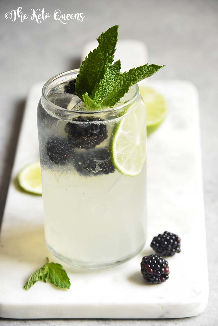 This low carb blackberry mojito recipe is a refreshing way to cool down in the heat. Fresh blackberries and sprigs of mint are the stars of this mocktail. This single serve drink is made in less than 5 minutes!