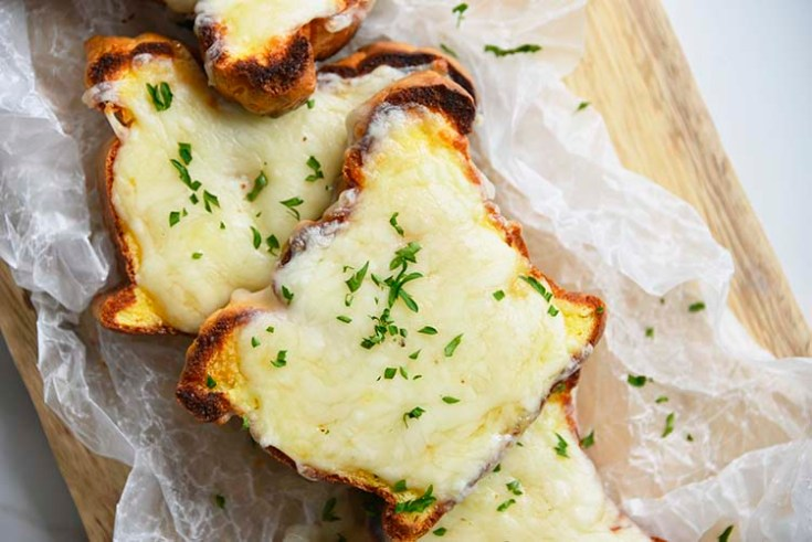 low carb Texas toast on a parchment paper topped with parsley