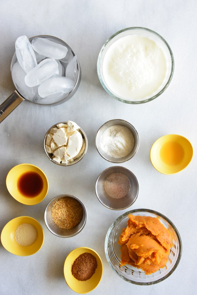 keto pumpkin smoothie ingredients on a white counter top