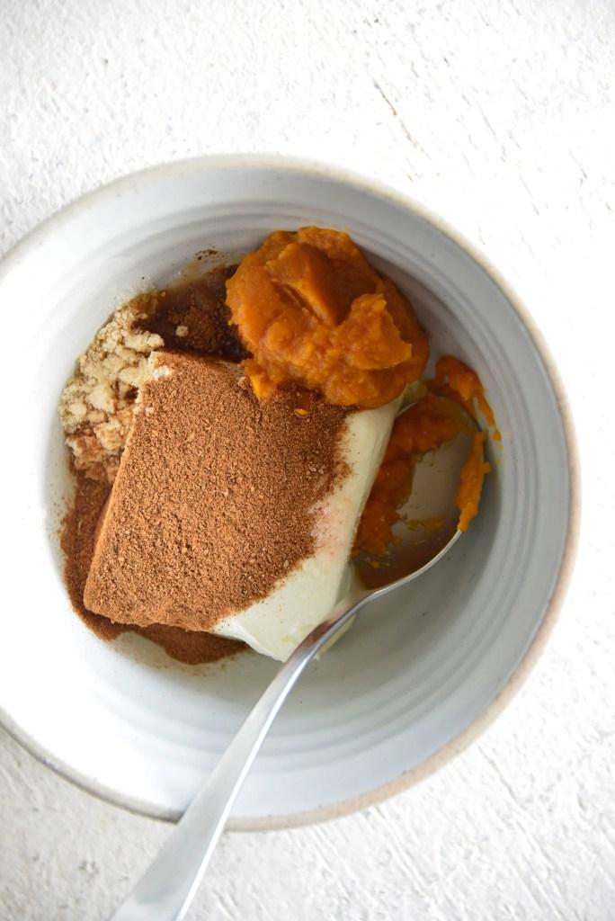 Keto PumpkinSpice Cream Cheese Fat Bombs ingredients in a white bowl ingredients in a white bowl