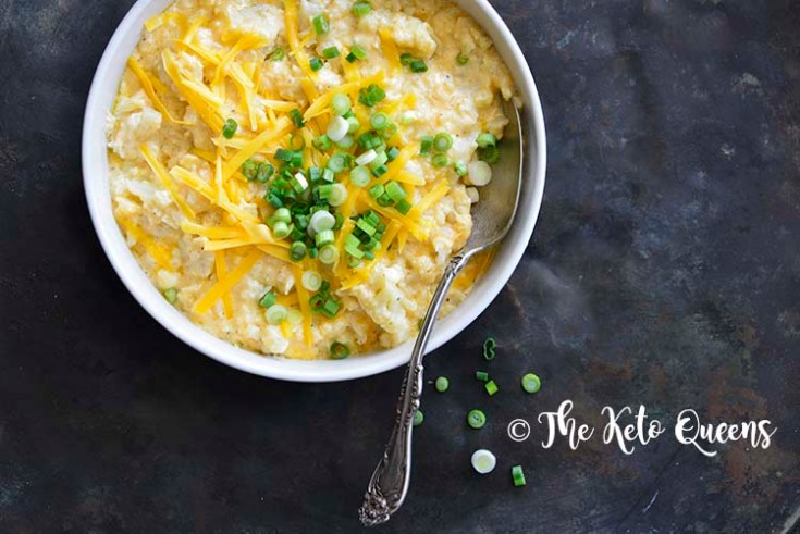 keto mac and cheese recipe in a white bowl topped with scallions