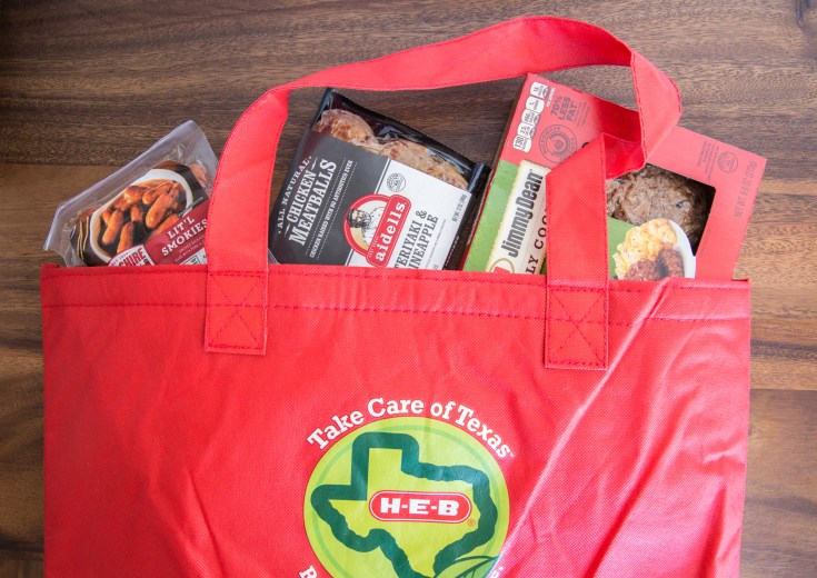 tyson products in an HEB red bag