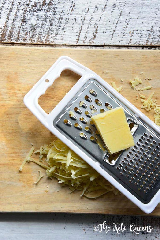 white organic valley block cheese being shredded