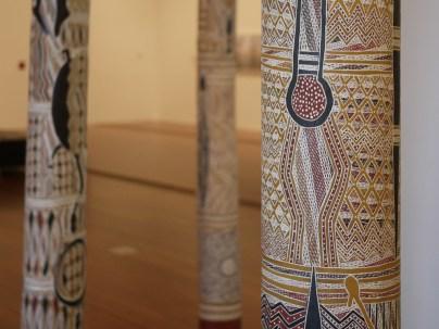 Larrakitj (hallow log coffins) painted by Gawirrin Gumana at NGV