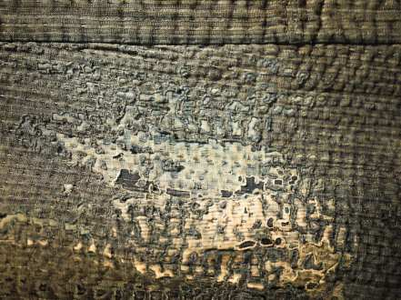 Detail of worn textile, Amuse Museum