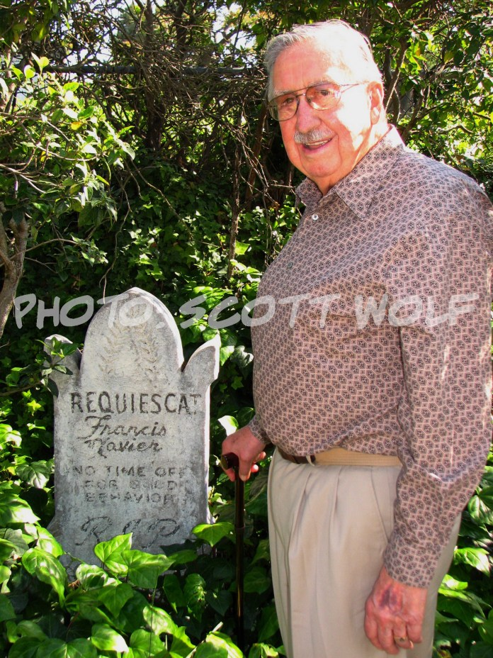 X Atencio in front of the Haunted Mansion tombstone he inspired. This version is in his backyard. Photo Credit: Scott Wolf at Mouse Clubhouse (www.mouseclubhouse.com)
