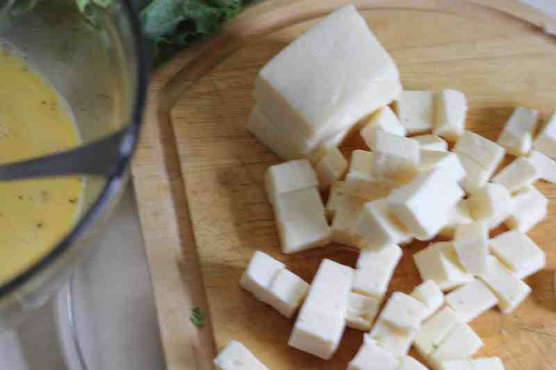 havarti cubed on wooden cutting board