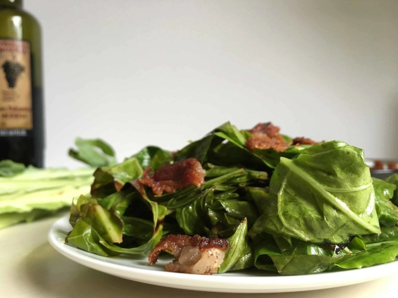 balsamic bacon collards served on white plate