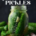 dill pickles in glass jar with a black background