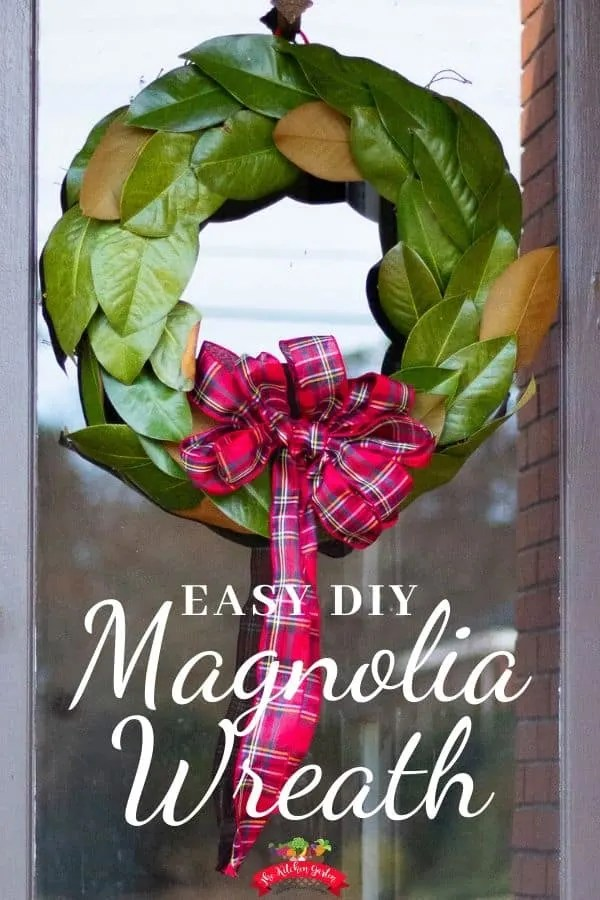 green magnolia wreath red bow