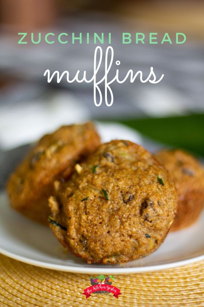 zucchini bread muffins on a white plate