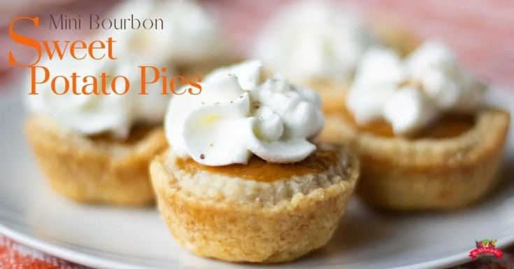mini bourbon sweet potato pies topped with whipped cream and a dusting of nutmeg