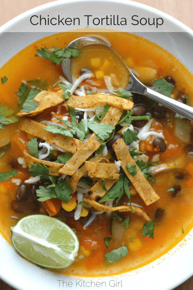 30-Minute Chicken Tortilla Soup uses rotisserie chicken, tomatoes, lime, cilantro, black beans, and corn. Gluten-free. thekitchengirl.com