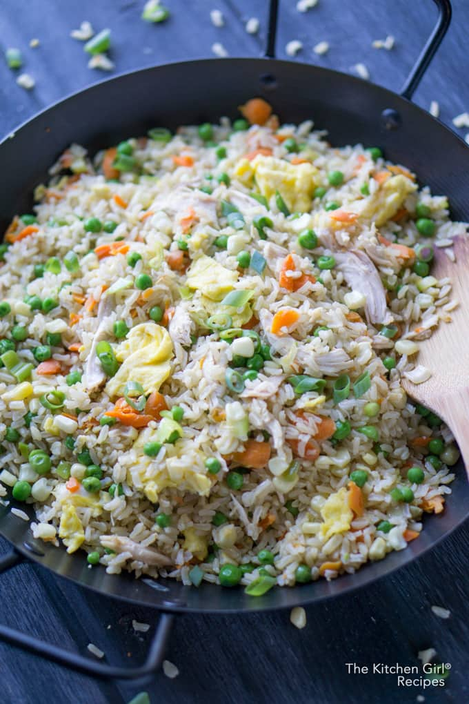 Skip the salty takeout and feed your army with this easy, one-skillet, Better Than Takeout Chicken Fried Brown Rice. thekitchengirl.com