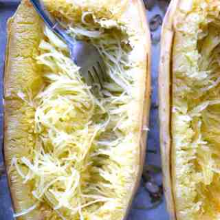 How to bake spaghetti squash and cut it after it's cooked #spaghettisquash #lowcarb #howtocook #wholespaghettisquash #wintersquash #whole30