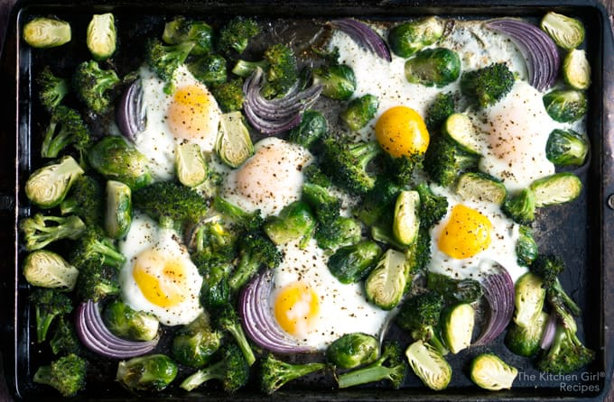 Hands-free, 20 min egg breakfast with ALL the veggies! Sheet Pan Baked Eggs Brussels Sprouts and Broccoli with red onion is baked not fried on thekitchengirl.com #bakedeggs #sheetpanbreakfast #sheetpanmeal #roastedvegetables #breakfast #healthybreakfast #brusselssprouts #bakednotfried #paleo