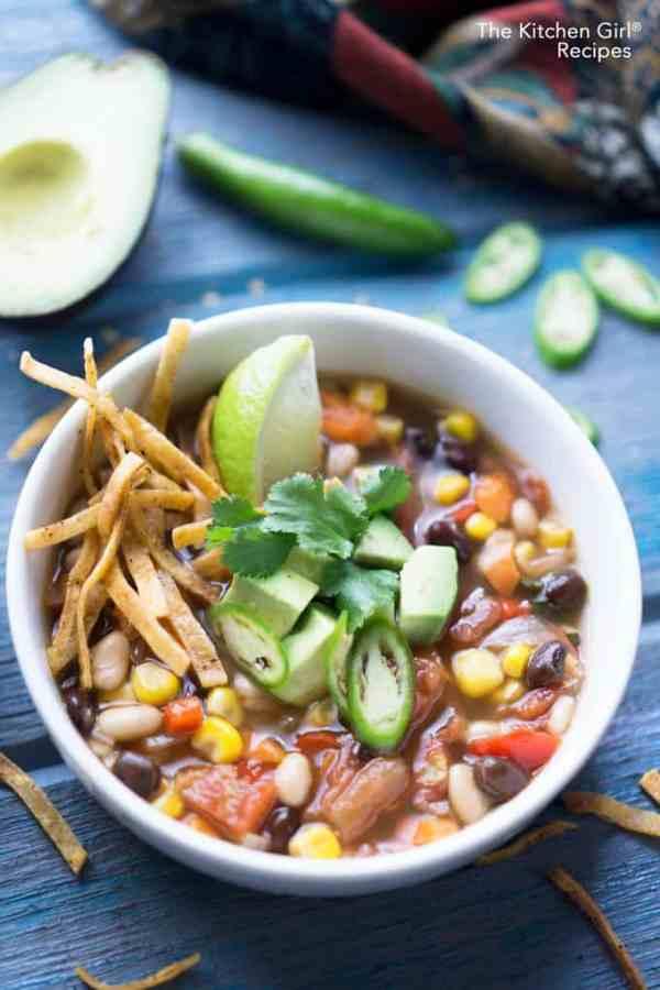 Easy, delicious, Mexican bean soup. 30 Minute Vegan Tortilla Soup. #vegansoup #healthymexican #blackbeans #avocado #vegetariansoup #tortillasoup #glutenfree #weeknightmeal