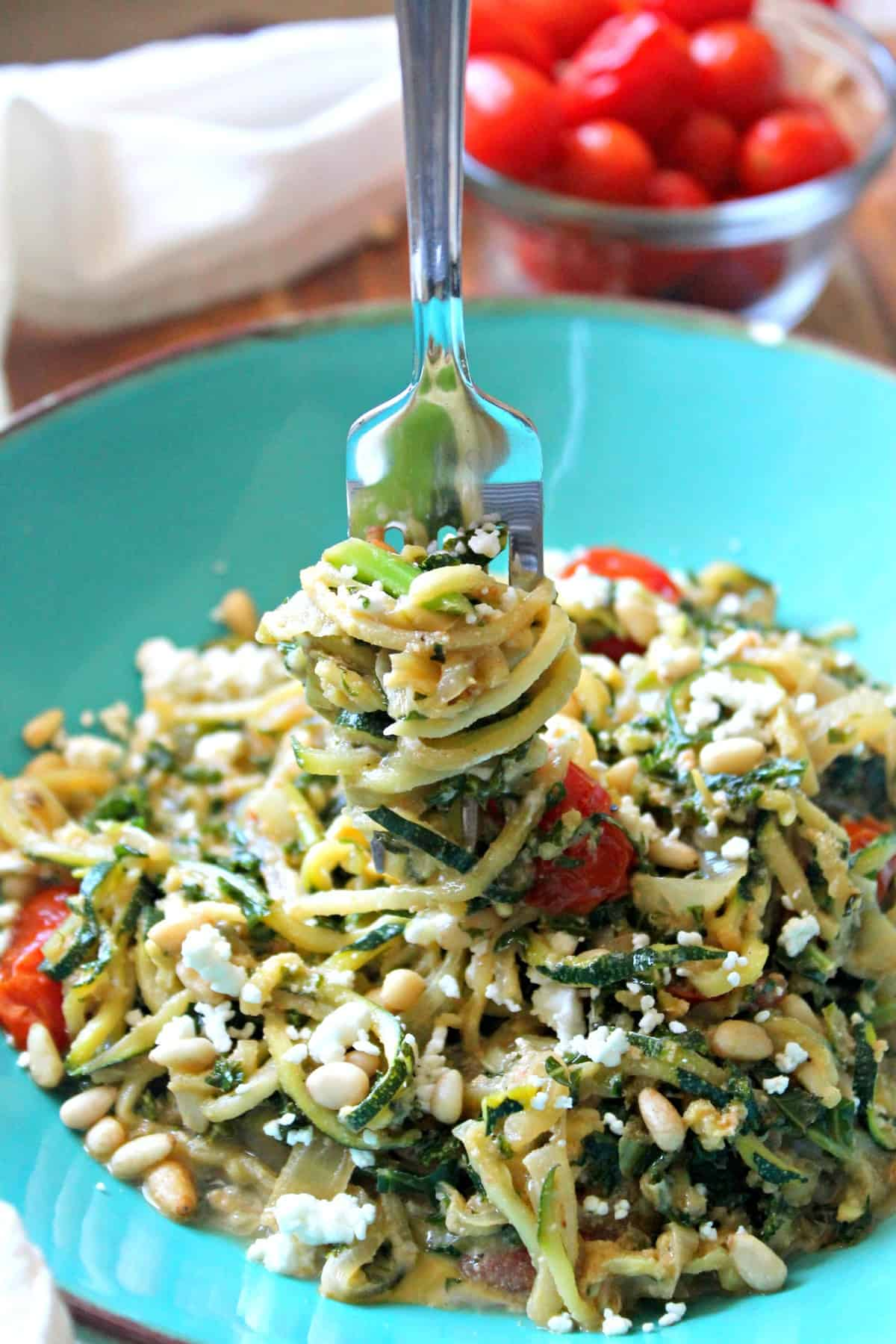 Need a way to use up that summer zucchini?Zucchini Noodles with Kale, Onion, and Goat Cheese will do the trick while giving you a veggie-filled dinner option that comes together in minutes! Topped with pine nuts for texture and an extra sprinkle of goat cheese, this simple dish is a great option for Meatless Mondays or a quick, healthy meal any day of the week.