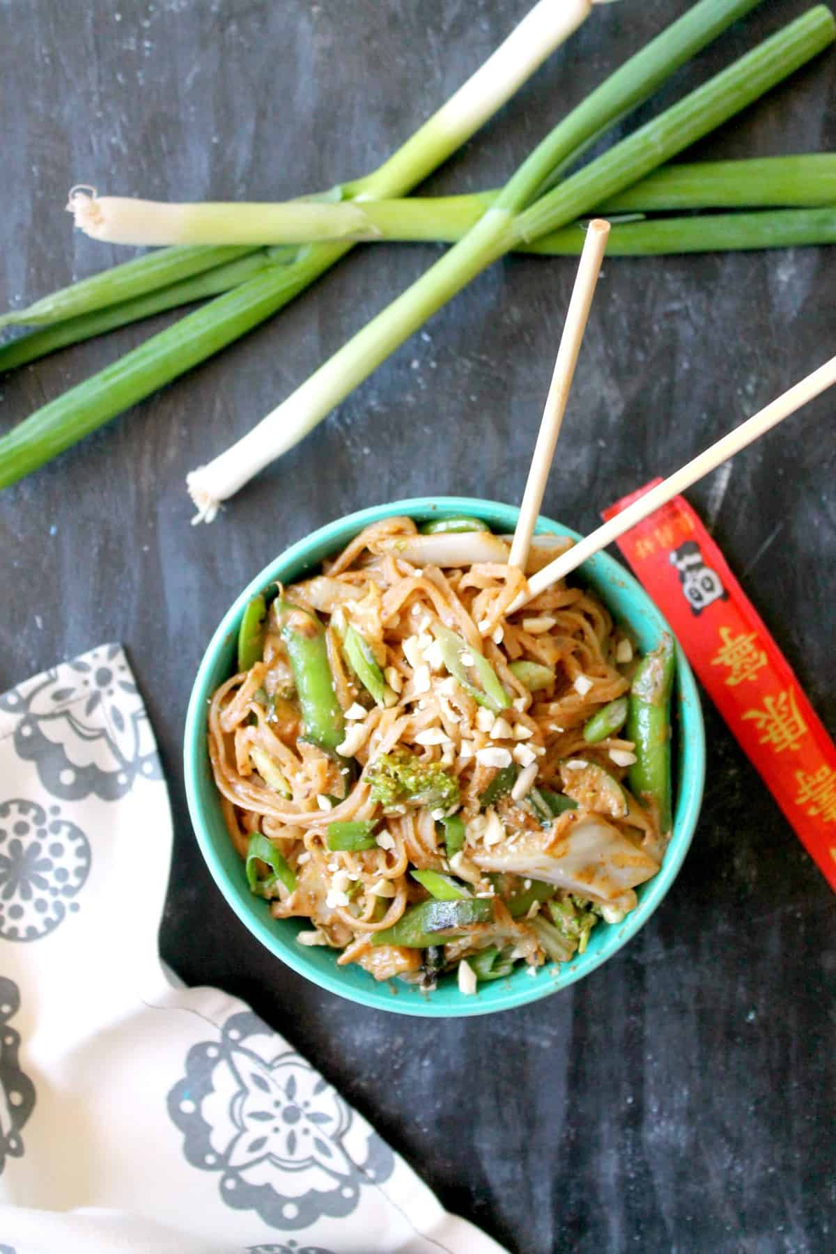 Almond Butter Noodle Stir Fry is a quick, satisfying meal that comes together in minutes! Whether you keep it vegetarian or add a protein to the mix, this is a fast meal that you'll want to have in your back pocket any day of the week!