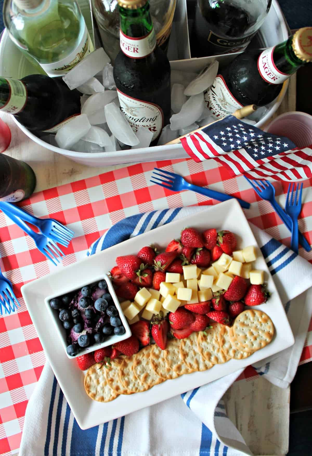 <em>The most patriotic plate at your 4th of July block party is sure to be this Old Glory-inspired cheese plate! Beautiful enough to double as a centerpiece, but easy enough to arrange in minutes, it's a true example of summer's easygoing entertaining vibes!</em>