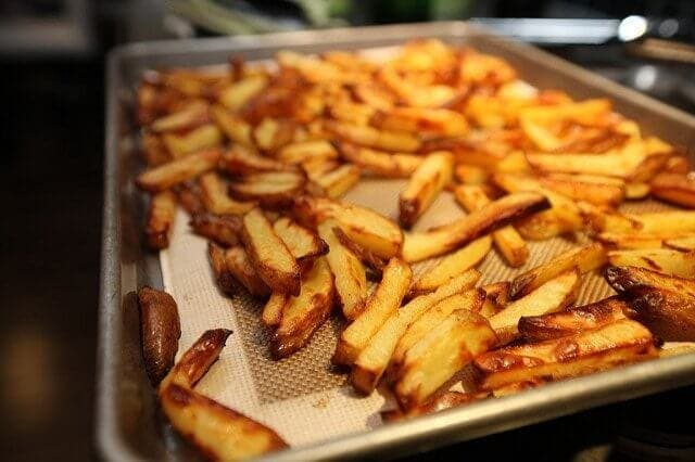 Bake fries and veggies in the oven instead of deep-frying them for healthier snacks.