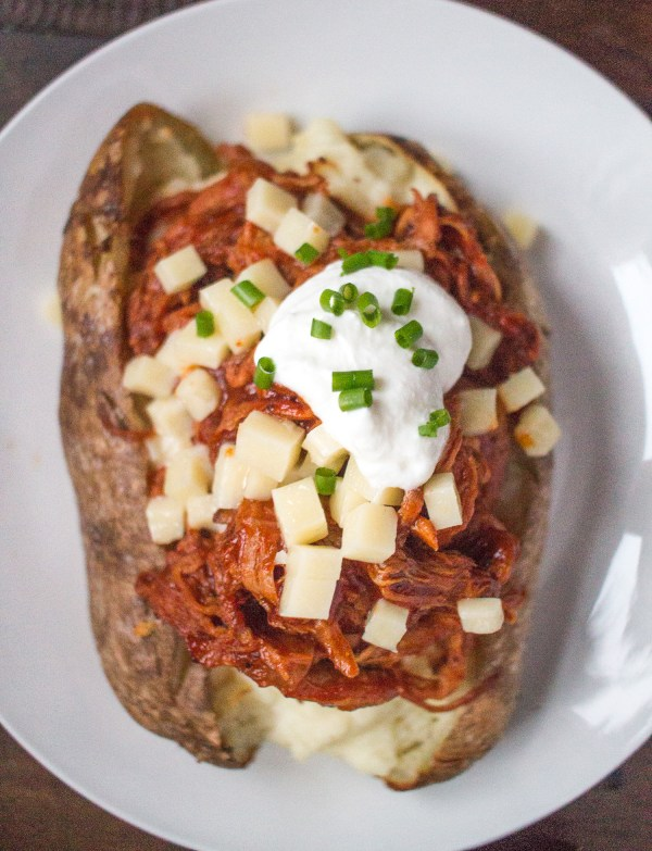 Pulled pork loaded baked potatoes thekittchen the trick to making the best baked potatoes is to cover the outside of the potatoes with butter and salt it makes the skin really crispy it is the only ccuart Choice Image