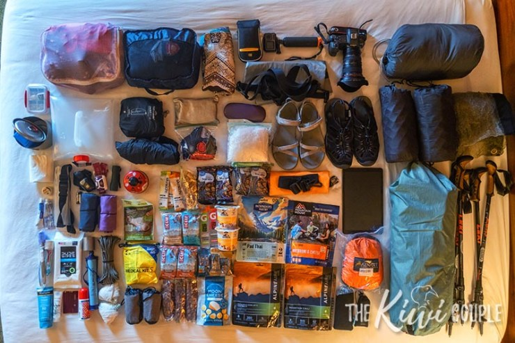 All of the things we packed for our Havasupai 3 night camping trip laid out on a bed