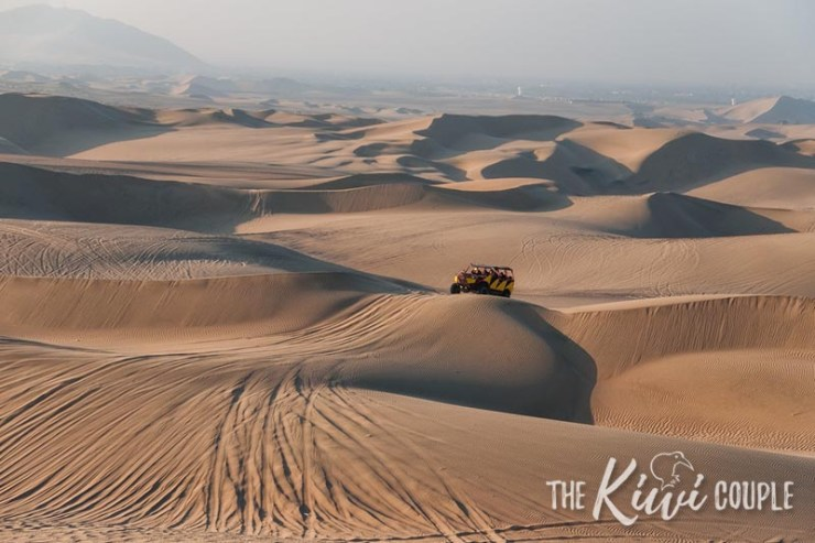 A sand buggy driving over the dunes of Huacachina